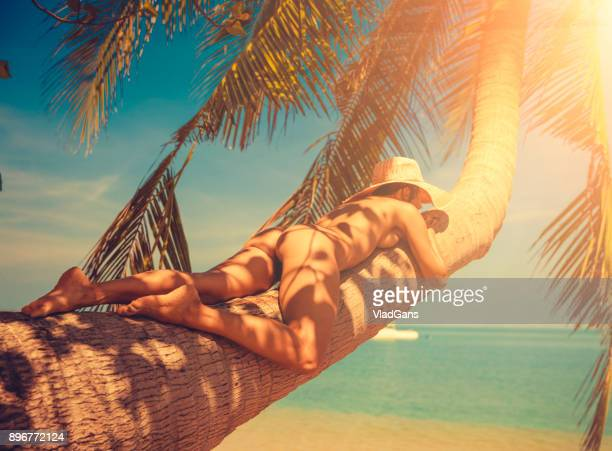 nude woman at tropical beach - naturist stock pictures, royalty-free photos & images