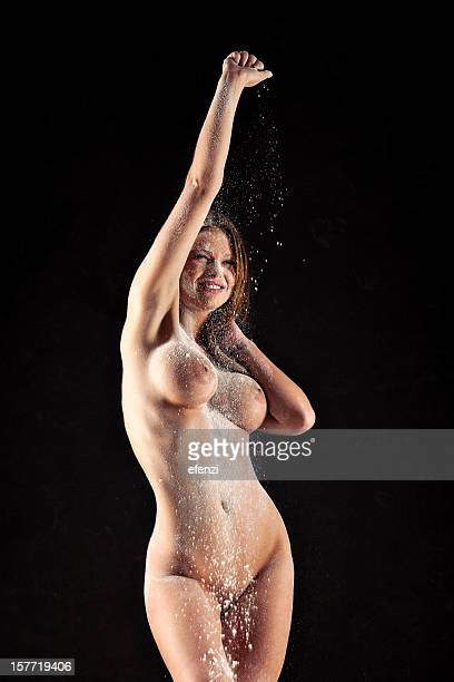 Nude Woman Dusting Herself With Powder