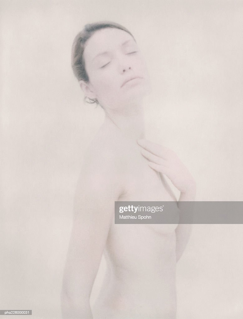 Nude woman, eyes closed, touching neck, portrait. : Stockfoto