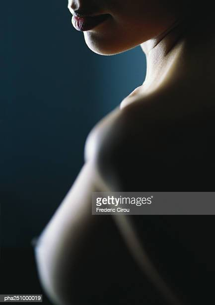 Nude woman, focus on mouth, close-up