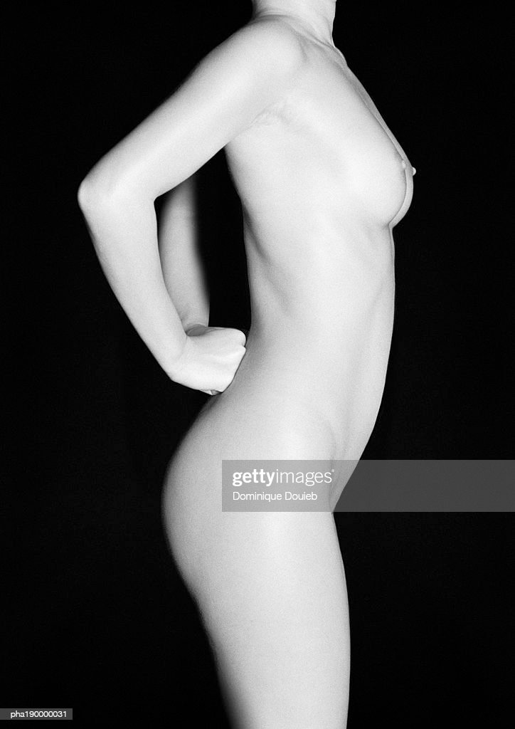 Nude woman, hands on back, side view. : Stockfoto