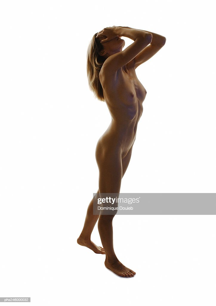 Nude woman, hands on head, high angle view : Stockfoto