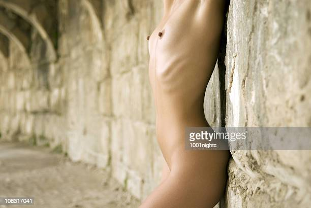 nude woman in amphitheater - old nudists stock pictures, royalty-free photos & images