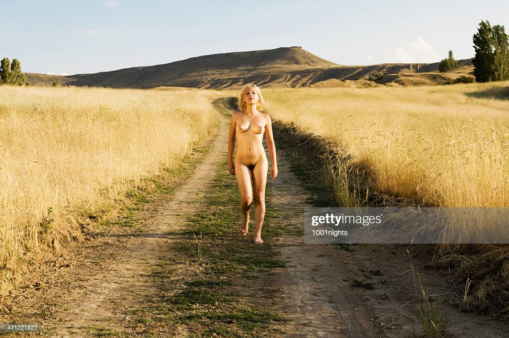 Nude woman in field : Stock Photo