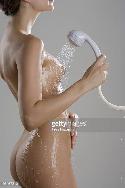 Nude woman in shower