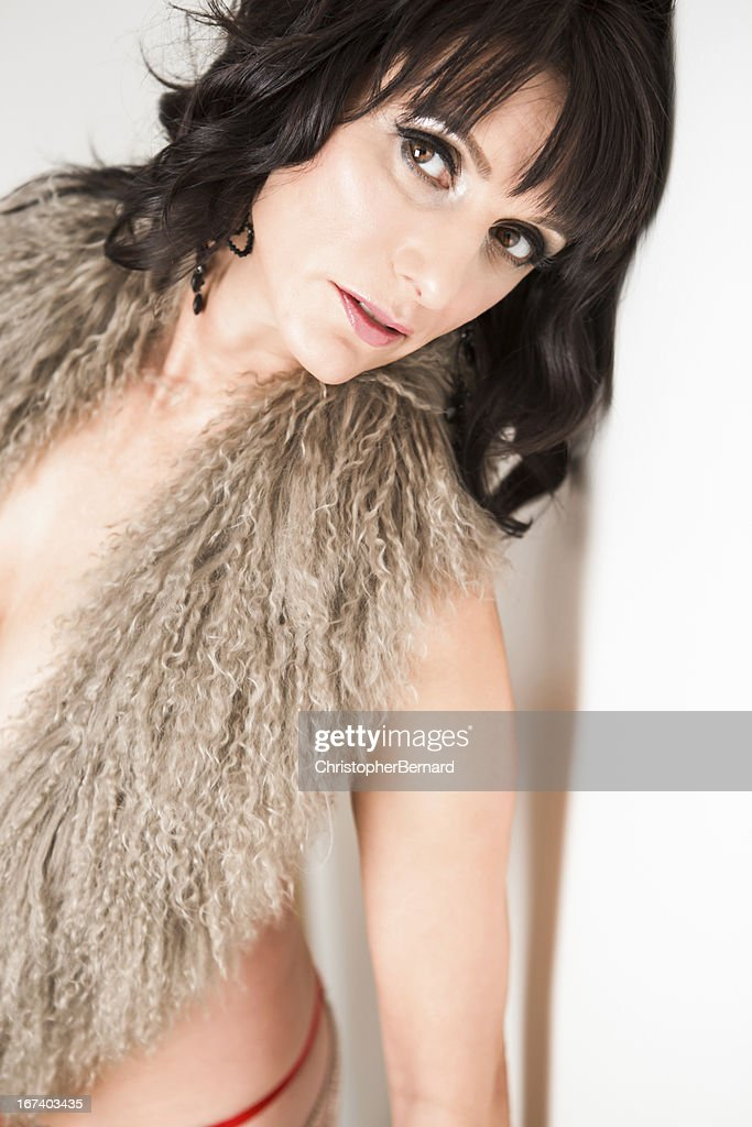 Nude woman leaning against wall : Stock Photo