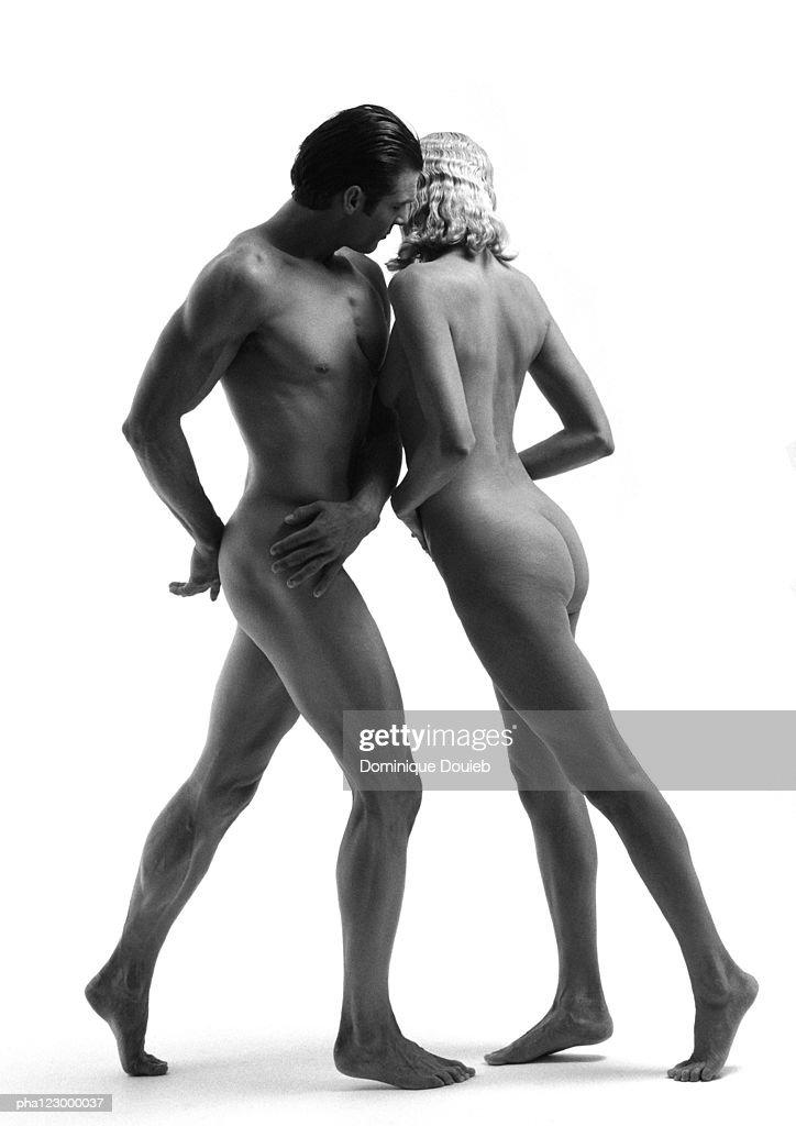 Nude woman leaning into nude man, B&W : Stockfoto