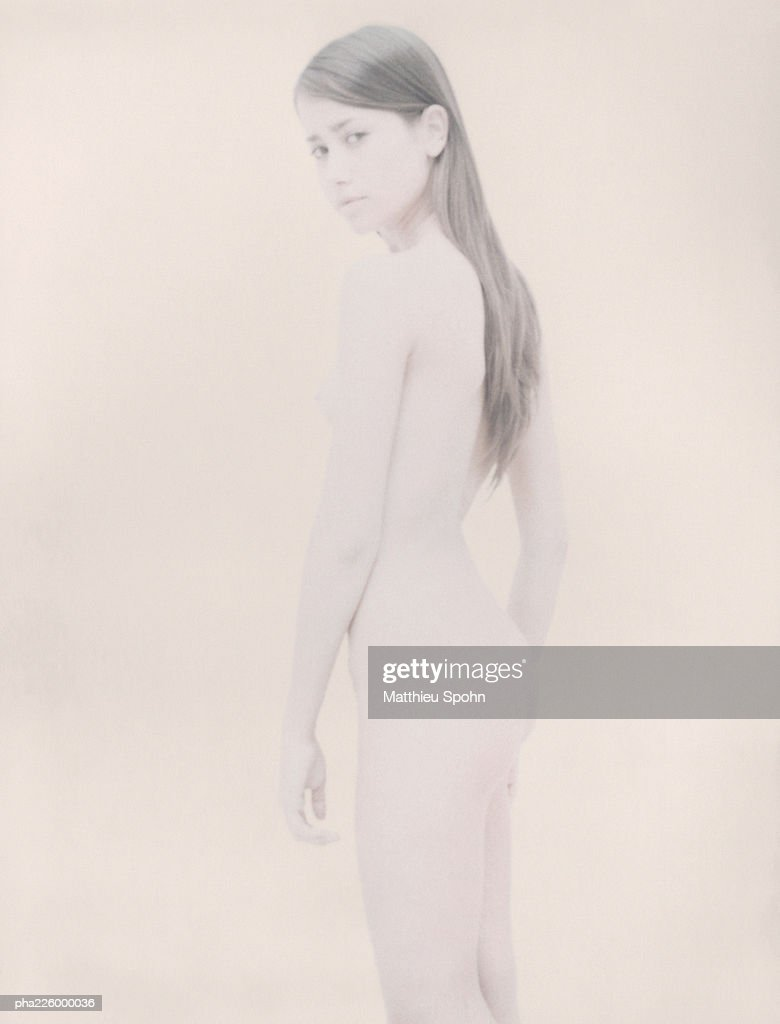 Nude woman looking into camera, side view. : Stockfoto