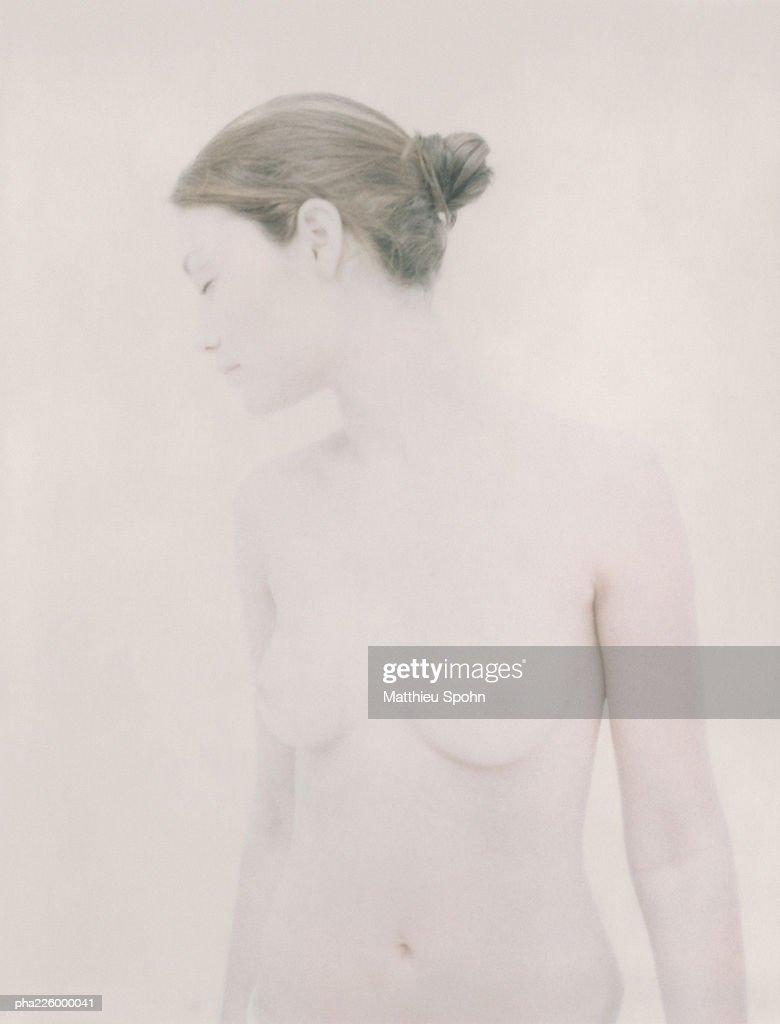 Nude woman, looking to side, portrait. : Stockfoto