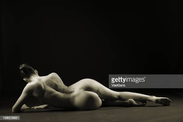 Nude woman lying on a floor