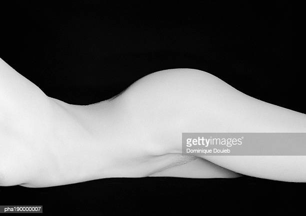 Nude woman lying on side, mid-section.