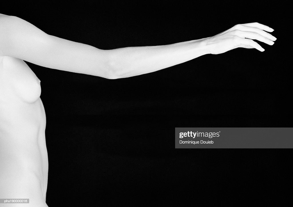 Nude woman reaching arm out. : Stockfoto