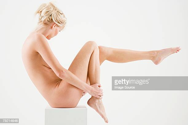 Nude woman sitting on a box