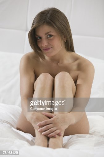 Nude Woman Sitting On Bed Stock Photo - Getty Images-5846