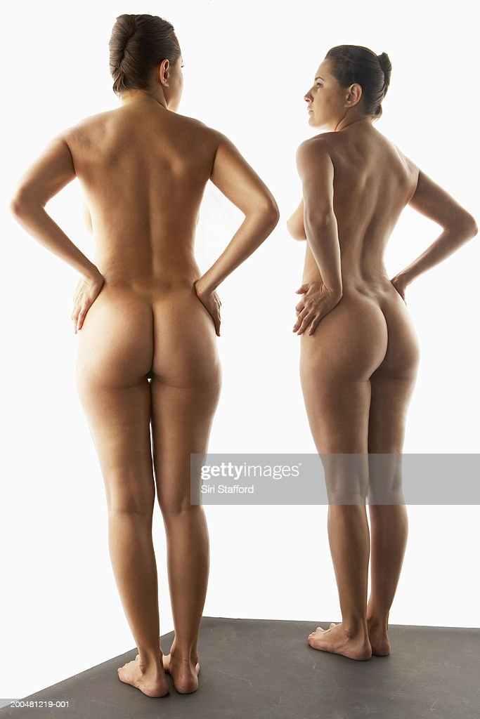 Nude Woman Standing In Front Of Mirror Photo  Getty Images-7394