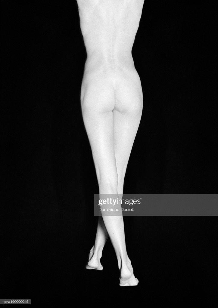 Nude woman standing, lower half, rear view. : Stockfoto