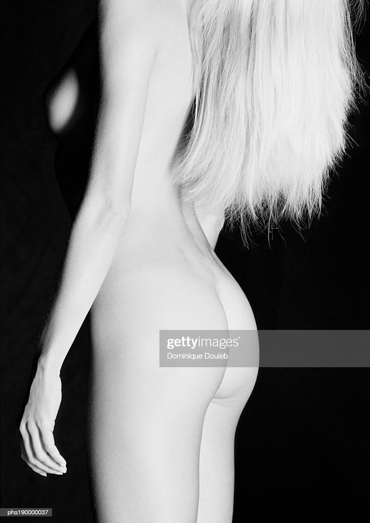 Nude woman standing, side view. : Stockfoto