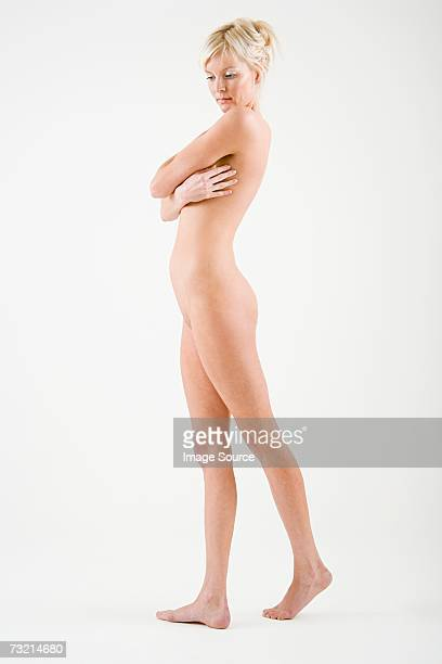 Nude woman with arms across chest