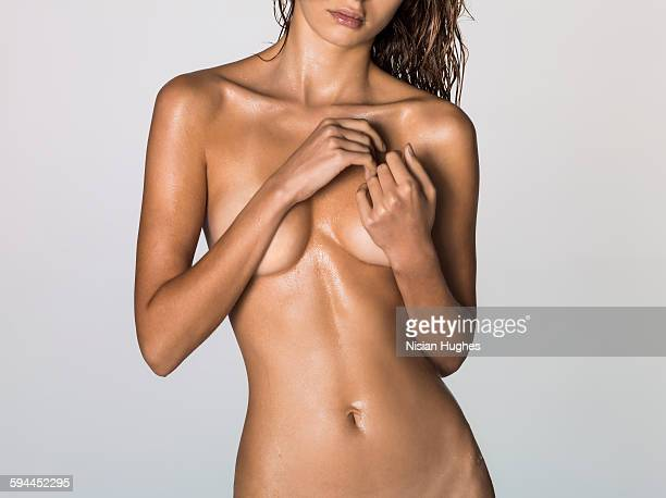 Nude woman with beautiful tanned skin