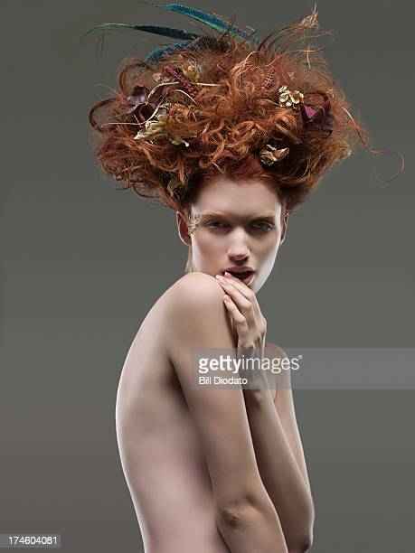 Nude woman with dried flowers in hair