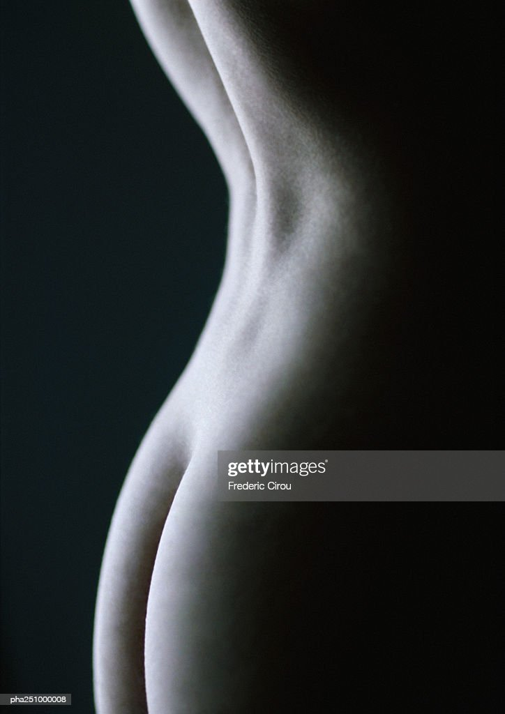 Nude woman's back and buttocks, close-up : Stockfoto