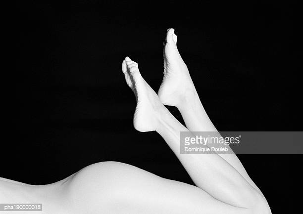 nude woman's buttocks, legs raised. - female bare bottoms stock pictures, royalty-free photos & images