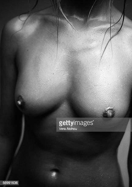 Nude woman's chest, close-up, B&W