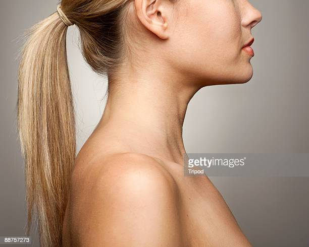Nude woman's shoulder and face, profile