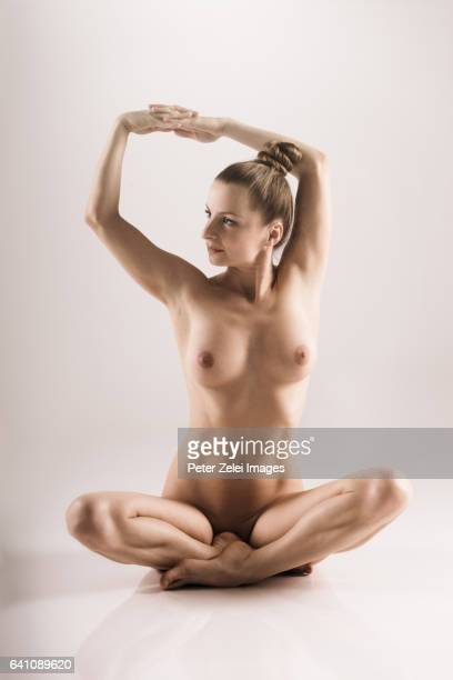 nude yoga asana - naturism stock photos and pictures