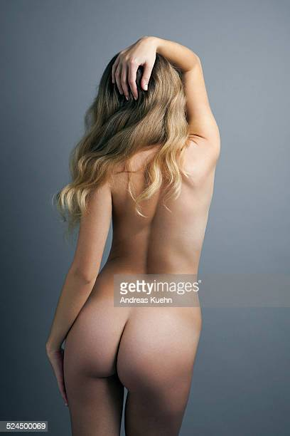nude young woman with her back towards camera. - bare bottom women stock photos and pictures