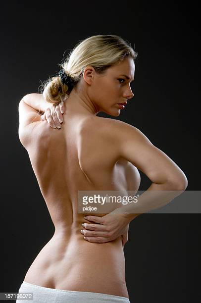 nude young women with hands on hip and shoulder