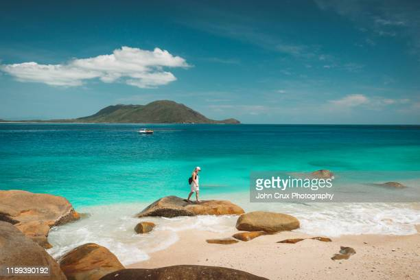 nudey beach backpackers - queensland stock pictures, royalty-free photos & images