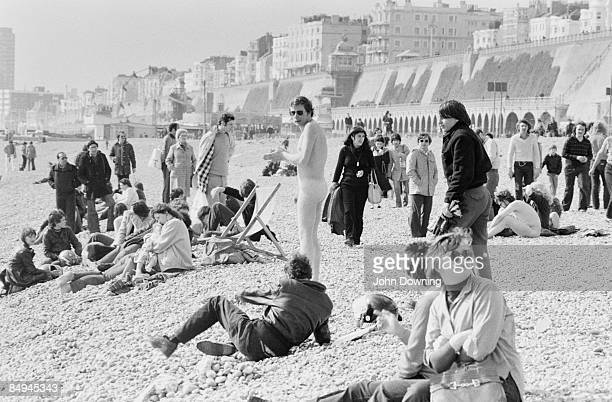A nudist beach opens in Brighton but only a brave few take advantage of it perhaps due to the cold April 1980