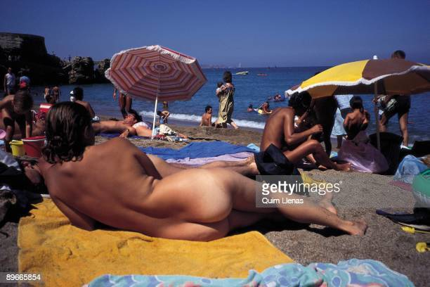 Nudist beach Tourists in a beach nudists of the Gerona province