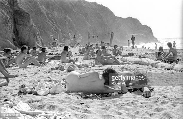 Nudist sunbathe at the Devil's Slide Free Beach in San Mateo County circa October 1974 south of San Francisco California
