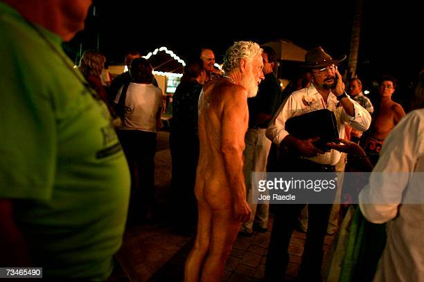 Nudists and politicians mill around together after a candidates debate for the open seats on the Loxahatchee Groves Town Council March 1 2007 at the...