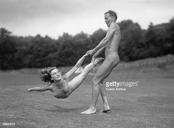Nudists engaging in some outdoor exercise