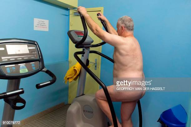 Nudists exercise in a fitness room of the Roger Le Gall swimming pool in Paris on January 12 2018 Every week some hours are reserved for naturists at...