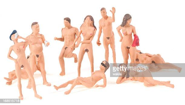 nudists figurines abstract - naturism stock photos and pictures