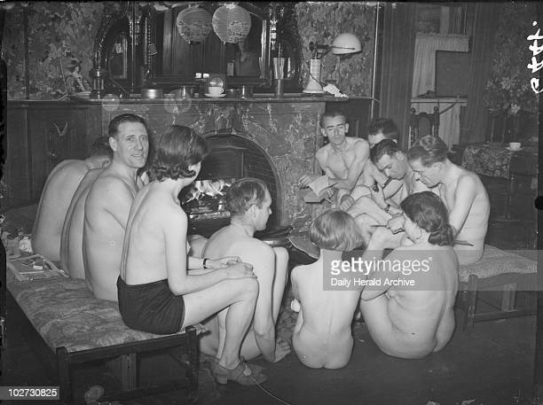 Nudists gathered at the fireside 1938 A photograph of nudists gathered at the fireside taken by Saidman for the Daily Herald newspaper on 1 May 1938...