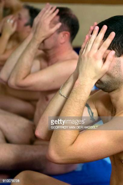 Nudists take part in a yoga lesson at the Roger Le Gall swimming pool in Paris on January 12 2018 Every week some hours are reserved for naturists at...