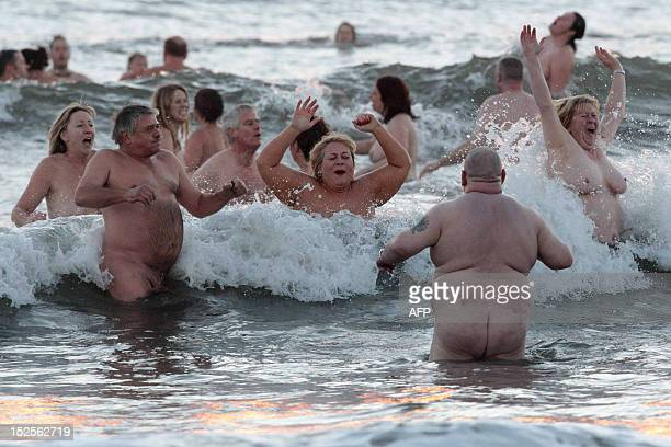 Nudists they take part in the North East Skinny Dip at Druridge Bay in Northumberland at sunrise on September 22 2012 Over 200 bathers braved the...