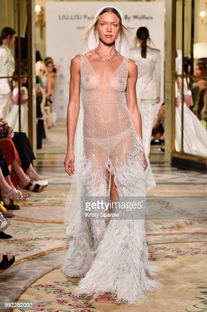 nudity in the picture] A model walks the runway at the Liu Lisi show as part of Paris Fashion Week Haute Couture Fall Winter 18/19 at Le Meurice on...