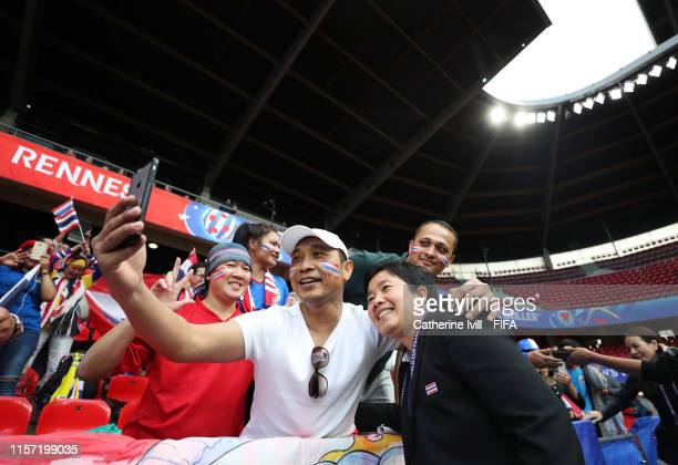 Nuengrutai Srathongvian Head Coach of Thailand poses for a photograph with fans prior to the 2019 FIFA Women's World Cup France group F match between...
