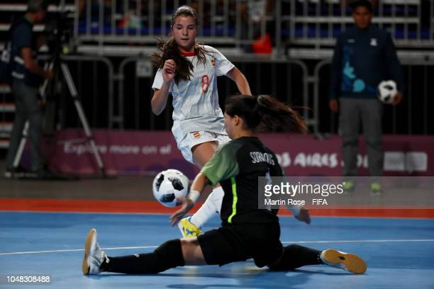 Nuengruthai Sorahong goalkeeper of Thailand makes a save on Antonia Martinez of Spain in the Women's Group C match between Thailand and Spain during...