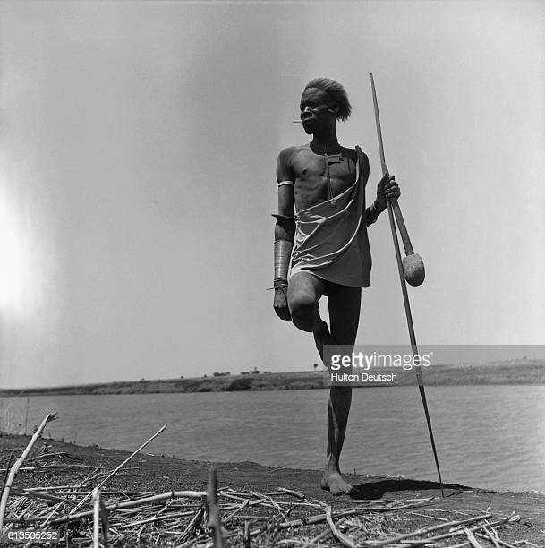 A Nuer tribesman of southern Sudan assumes a typical pose
