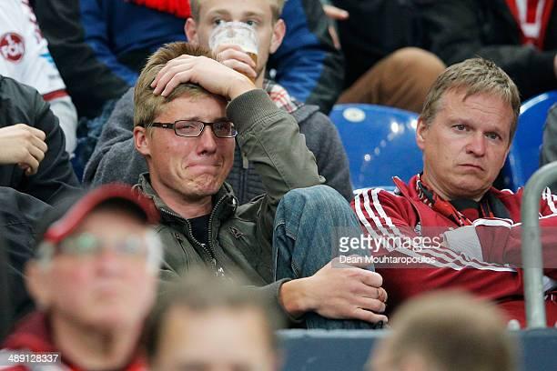 Nuernberg fan looks dejected with confirmed relegation after the Bundesliga match between FC Schalke 04 and 1. FC Nuernberg held at Veltins-Arena on...