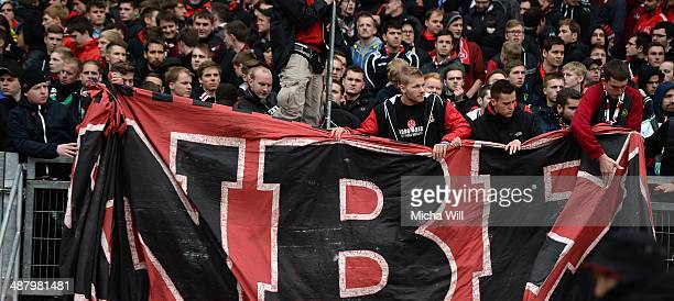 Nuernbergs fan group Ultras pack up their banners 30 minutes before the end of the Bundesliga match between 1 FC Nuernberg and Hannover 96 at Grundig...