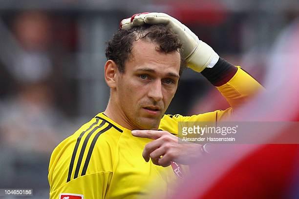 Nuernberg's keeper Raphael Schaefer looks on after attacked by Jermaine Jones of Schalke during the Bundesliga match between 1 FC Nuernberg and FC...