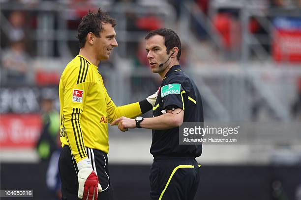 Nuernberg's keeper Raphael Schaefer taks to referee Marco Fritz after attacked by Jermaine Jones of Schalke during the Bundesliga match between 1 FC...